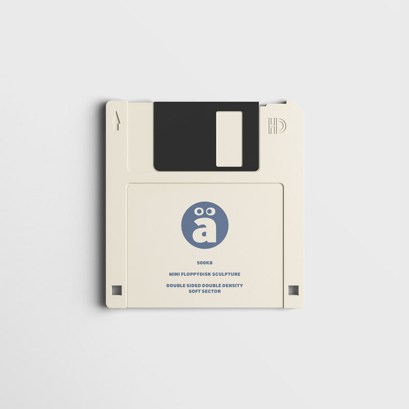 a Face Logo floppy disk Artwork Sculpture Beige